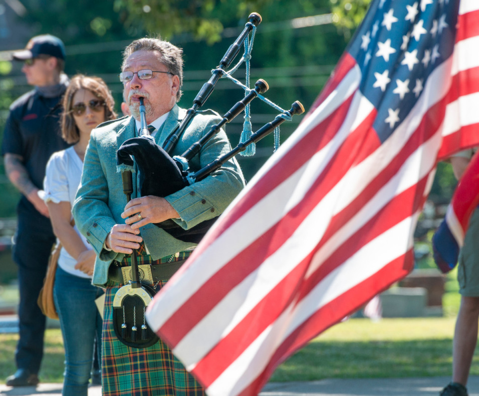 <strong>Bagpipe player, Gary Goldsmith, plays Amazing Grace at the Memorial Day service in Arlington, Tennessee Monday, May 31, 2021.</strong> (Greg Campbell/Special to Daily Memphian)