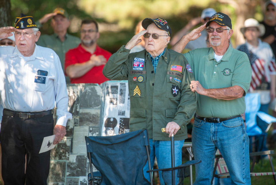 <strong>Tom Miller, Jim Young, center, and Harry McKee salute during the Pledge of Allegiance at the Arlington Memorial Day service, Monday, May 31, 2021.</strong> (Greg Campbell/Special to Daily Memphian)
