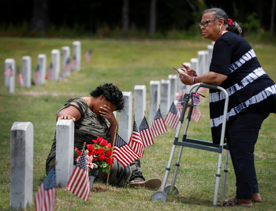 <strong>Family and friends visit loved ones on Memorial Day at the West Tennessee Veterans Cemetery on Monday, May 31, 2021.</strong> (Mark Weber/The Daily Memphian)