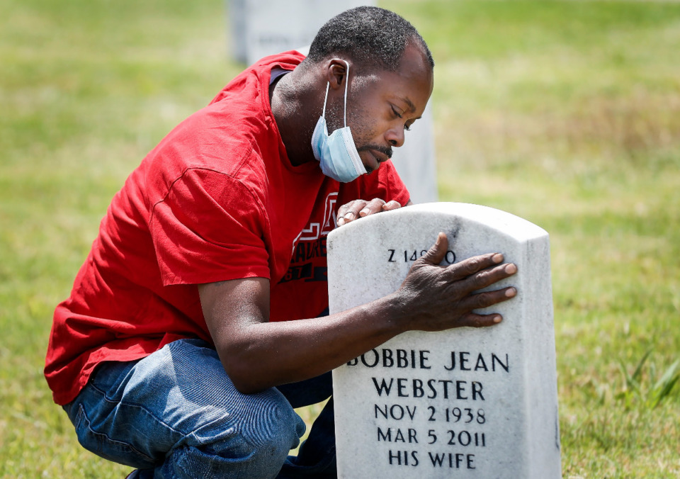 <strong>Antonio Webster hugs his grandparent&rsquo;s tombstone on Memorial Day at the West Tennessee Veterans Cemetery on Monday, May 31, 2021.</strong> (Mark Weber/The Daily Memphian)