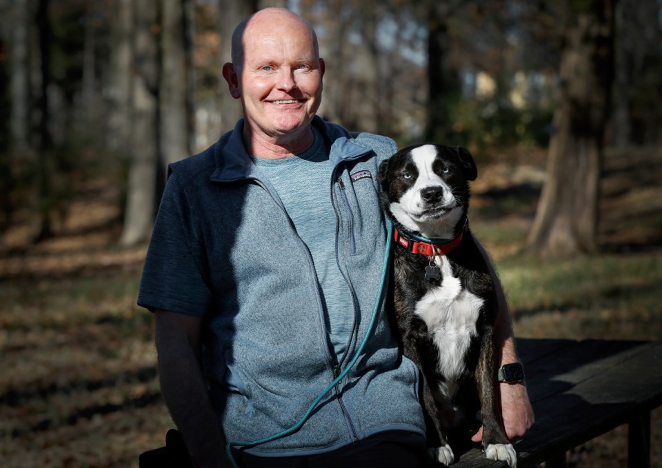 <strong>Phil Bryant, former owner of Bryant's Breakfast, and his dog Sky, are seen here on Dec. 22, 2020 at the dog park in Shelby Farms. Bryant died Monday, May 31, 2021 at age 57.</strong> (Mark Weber/The Daily Memphian)
