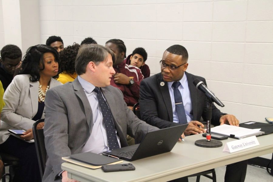 <span><strong>Gateway University leader Sosepriala Dede (right) confers with an associate before the hearing. His charter school has been recommended for closure.</strong> (Caroline Bauman/Chalkbeat Tennessee)</span>