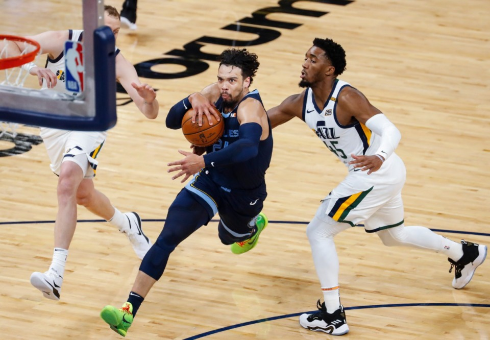 <strong>Memphis Grizzlies guard Dillon Brooks (left) drives the lane against Utah Jazz defender Donovan Mitchell (right) during action of game four of the NBA Playoffs on Monday, May 31, 2021</strong>. (Mark Weber/The Daily Memphian)