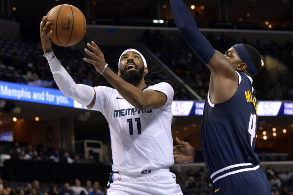 <strong>Memphis Grizzlies guard Mike Conley (11) shoots against Denver Nuggets forward Paul Millsap (4) Monday, Jan. 28, 2019, at FedExForum. The Nuggets edged out Memphis 95-92.</strong>&nbsp;(AP Photo/Brandon Dill)