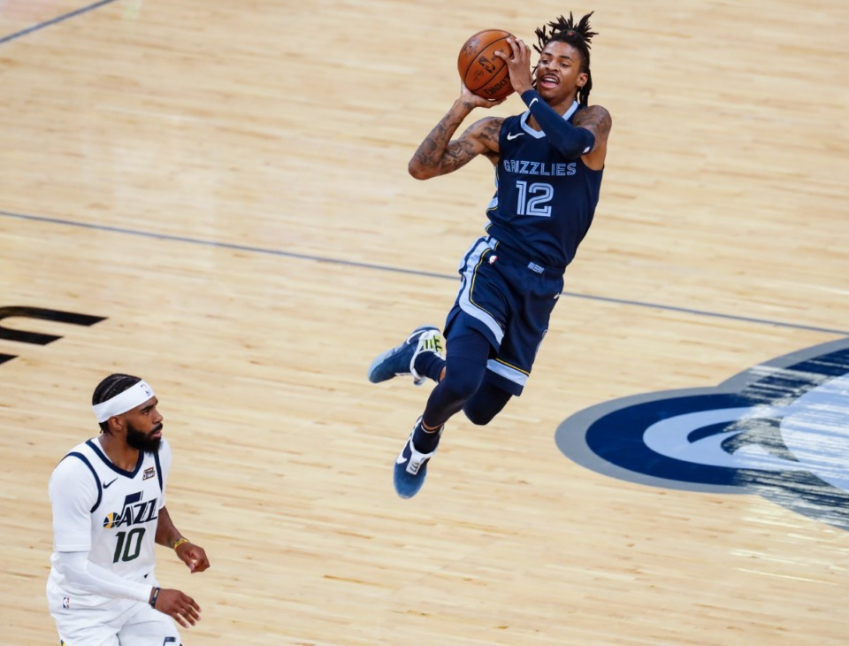 <strong>Memphis Grizzlies guard Ja Morant (right) puts up a shot after being fouled by Utah Jazz defender Mike Conley (left) during action of game four of the NBA Playoffs on Monday, May 31, 2021.</strong> (Mark Weber/The Daily Memphian)