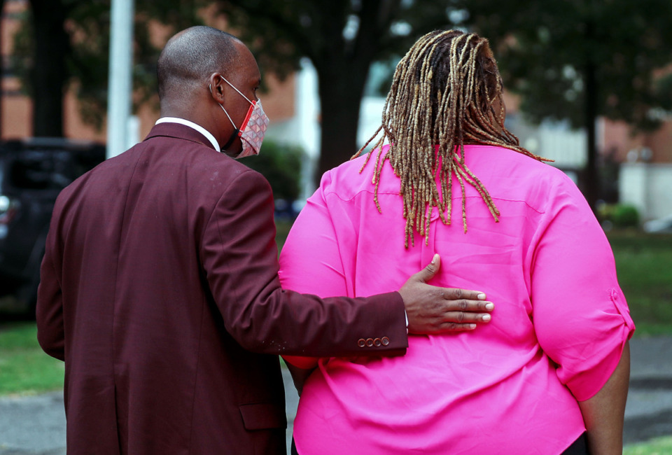 <strong>Shelby County Commissioner Van Turner comforts his fellow commissioner Tami Sawyer after an emotional press conference where she was confronted by a pro-confederate man who identified himself as K-Rack Johnson June 1, 2021.</strong> (Patrick Lantrip/Daily Memphian)