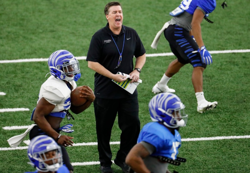 <strong>Memphis defensive coordinator Mike MacIntyre (middle) during practice on Tuesday, March 23, 2021.</strong> (Mark Weber/The Daily Memphian file)