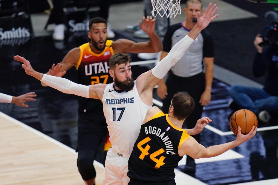 <strong>Grizzlies center Jonas Valanciunas (17) defends as Utah Jazz forward Bojan Bogdanovic (44) passes the ball on June 2, 2021, in Salt Lake City.</strong> (Rick Bowmer/AP)