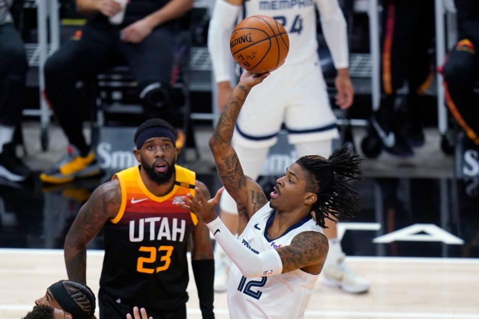 <strong>Grizzlies guard Ja Morant (12) shoots as Utah Jazz forward Royce O'Neale (23) watches on June 2, 2021, in Salt Lake City.</strong> (Rick Bowmer/AP)