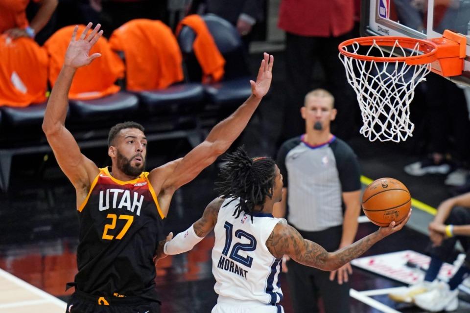 <strong>Memphis Grizzlies guard Ja Morant (12) goes to the basket past Utah Jazz center Rudy Gobert (27) on June 2, 2021, in Salt Lake City.</strong> (Rick Bowmer/AP)