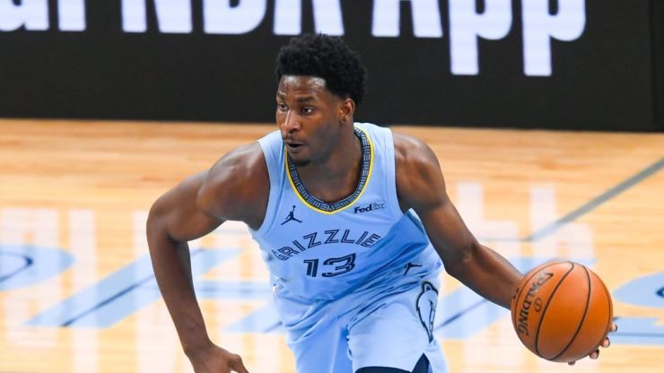 Memphis Grizzlies forward Jaren Jackson Jr. brings the ball up the floor during the second half of Game 3 of an NBA basketball first-round playoff series against the Utah Jazz, Saturday, May 29, 2021, in Memphis, Tennessee. (AP Photo/John Amis)