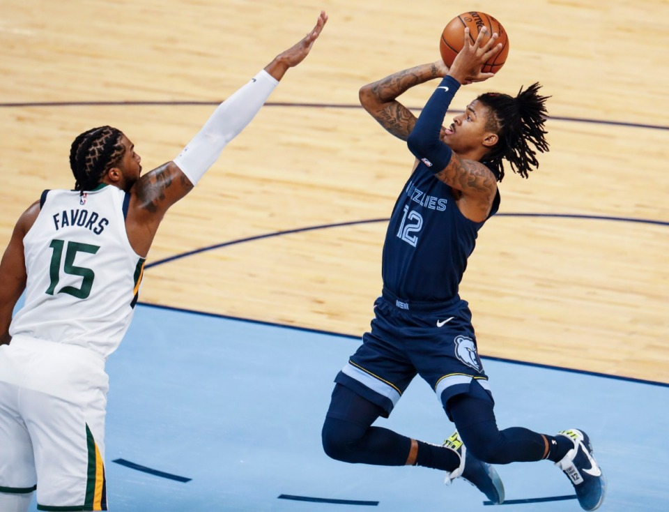 <strong>Memphis Grizzlies guard Ja Morant (right) puts up a shot in front of Utah Jazz defender Derrick Favors (left) during action of game four of the NBA playoffs on Monday, May 31, 2021.</strong> (Mark Weber/The Daily Memphian)