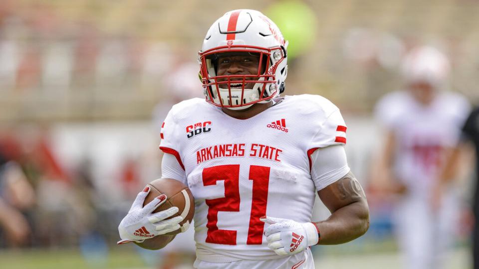 <strong>Arkansas State running back Jamal Jones (21) carries the ball in 2020. The former Trezevant star has been named director of letterwinner relations at Arkansas State.</strong> (AP file)