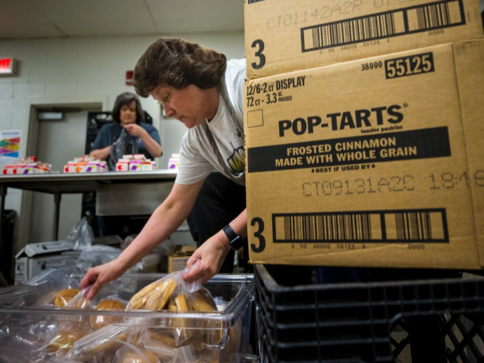 <strong>Arlington Community Schools associates Glenda Cain (front) and Rhonda Hubbert prepare lunches for student&nbsp; families at Arlington High School on June 3, 2021.</strong> (Ziggy Mack/Special to The Daily Memphian)