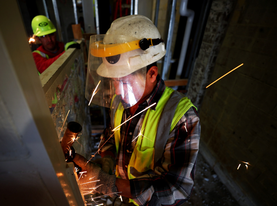 <strong>Francisco De Paz, a construction worker for FlintCo, grinds down a bar during demolition inside Bartlett High School. The $60 million renovation will unveil in phases &ndash; including new classrooms, a fine arts building, gym and cafeteria.</strong> (Houston Cofield/Daily Memphian)