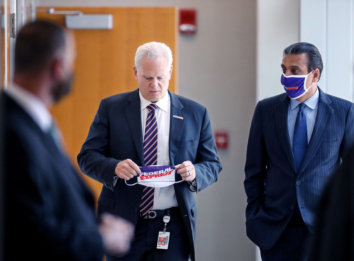 <strong>FedEx regional president of the Americas Richard Smith (center) and CEO Raj Subramaniam walk into a meeting with Secretary of Transportation Pete Buttigieg June 3, 2021.</strong> (Patrick Lantrip/Daily Memphian)