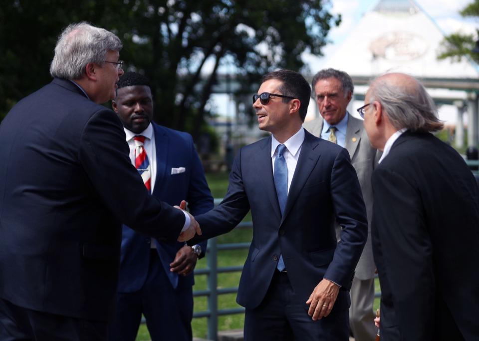 <strong>Secretary of Transportation Pete Buttigieg shakes hands with Memphis Mayor Jim Strickland Downtown on June 3, 2021.</strong> (Patrick Lantrip/Daily Memphian)