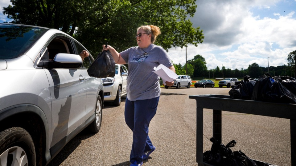 <strong>Arlington Community Schools associate Tamara Harris delivers prepared lunches to student body families at Arlington High School on June 3, 2021.</strong> (Ziggy Mack/Special to The Daily Memphian)