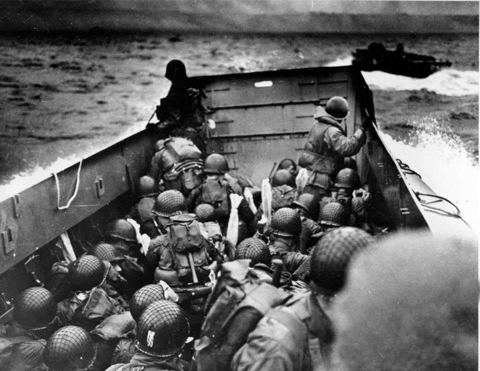 <strong>In this photo provided by the U.S. Coast Guard, a U.S. Coast Guard landing barge, tightly packed with helmeted soldiers, approaches the shore at Normandy, France, during initial Allied landing operations, June 6, 1944. These barges ride back and forth across the English Channel, bringing wave after wave of reinforcement troops to the Allied beachheads.</strong> (AP Photo/U.S. Coast Guard)