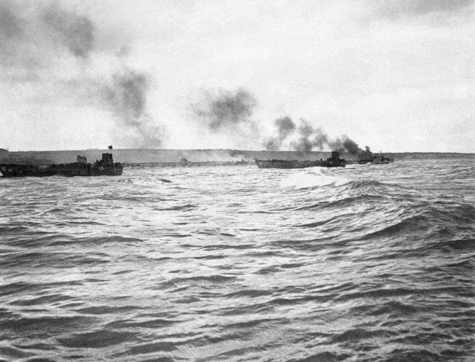 <strong>Allied landings craft of unidentified type, right, burns just off the shore somewhere on the north coast of France on June 6, 1944 during the invasion of Fortress Europe.</strong> (AP Photo)