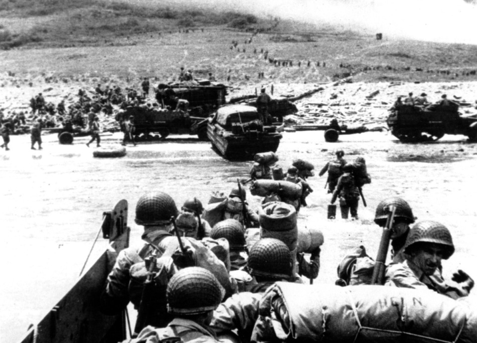 <strong>Ducks (amphibious trucks) and a half-track follow foot troops ashore during the World War II opening invasion of France on a 100-mile front along the Normandy coast by Allied forces on June 6, 1944.</strong> (AP Photo/U.S. Coast Guard)