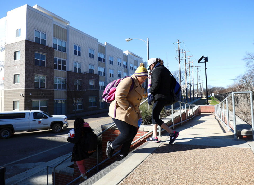 <strong>University of Memphis students walk in front of Gather on Southern toward campus for class on Tuesday, Jan. 29, 2019. The University of Memphis board of trustees is considering increasing police presence near the building in response to recent criminal activity in the area.</strong> (Houston Cofield/Daily Memphian)