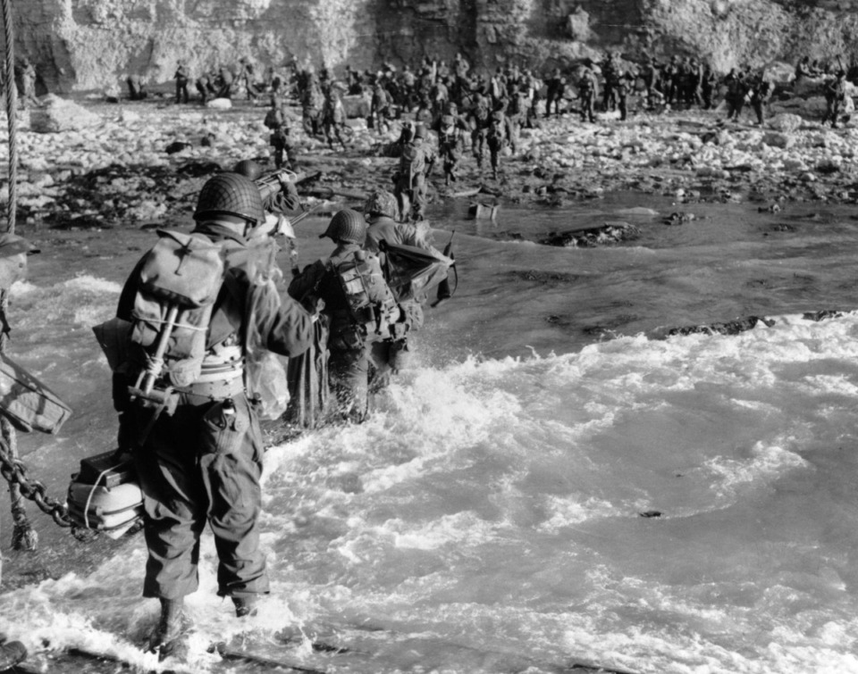 <strong>U.S. reinforcements wade through the surf as they land at Normandy in the days following the Allies' June 1944, D-Day invasion of occupied France.</strong> (AP Photo)