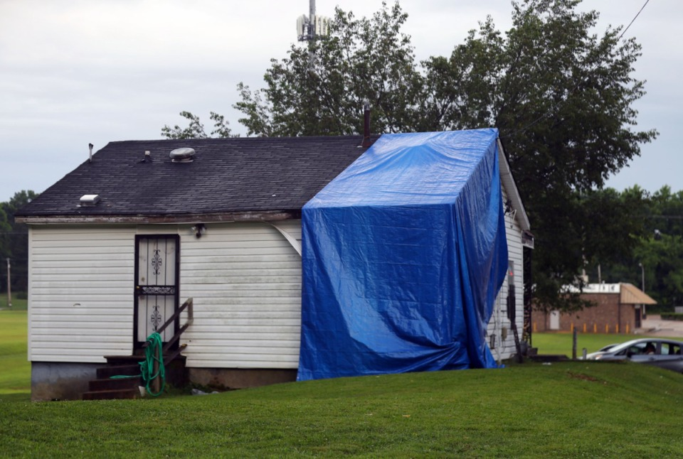 <strong>A tarp covers the hole left by a car that struck former NBA player Galen Young while he was sitting in the living room of his mother's house in Southwest Memphis June 5, 2021.</strong> (Patrick Lantrip/Daily Memphian)