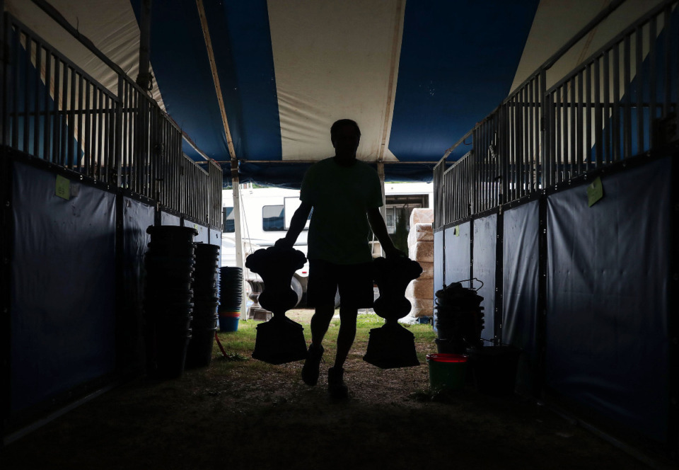 <strong>Beanie Cone sets up for the Germantown Horse Show June 5, 2021.</strong> (Patrick Lantrip/Daily Memphian)