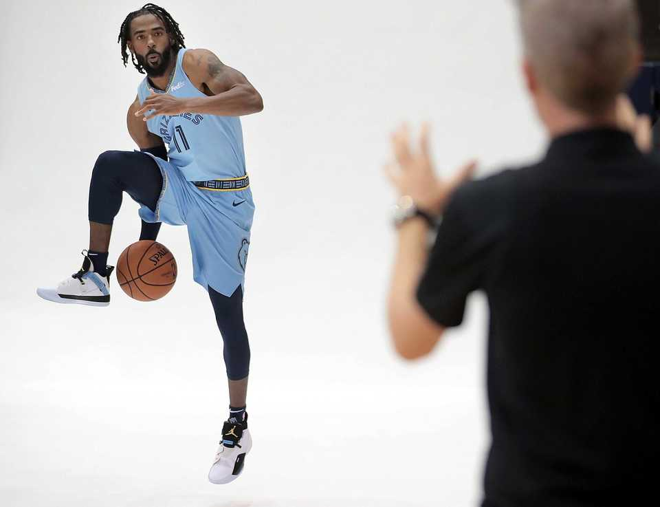 <strong>Mike Conley adds a little action to his portrait sitting during the annual Grizzlies media day at the FedExForum on Sept. 24, 2018.</strong> (Jim Weber/Daily Memphian)