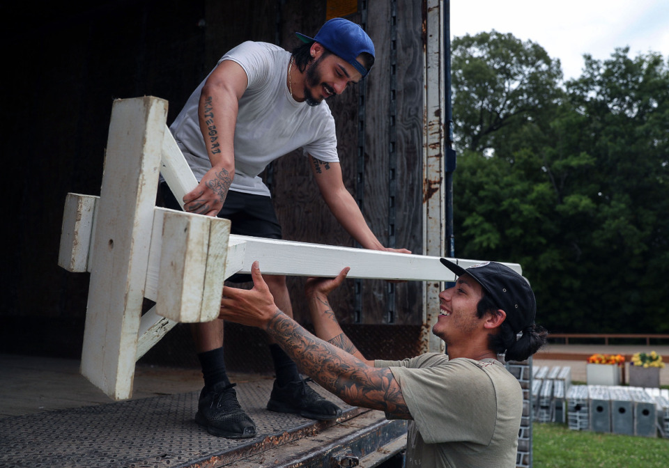 <strong>Ricky Soto (left) and Andrew Suh unload horse jumps in preparation for the Germantown Horse Show June 5, 2021.</strong> (Patrick Lantrip/Daily Memphian)