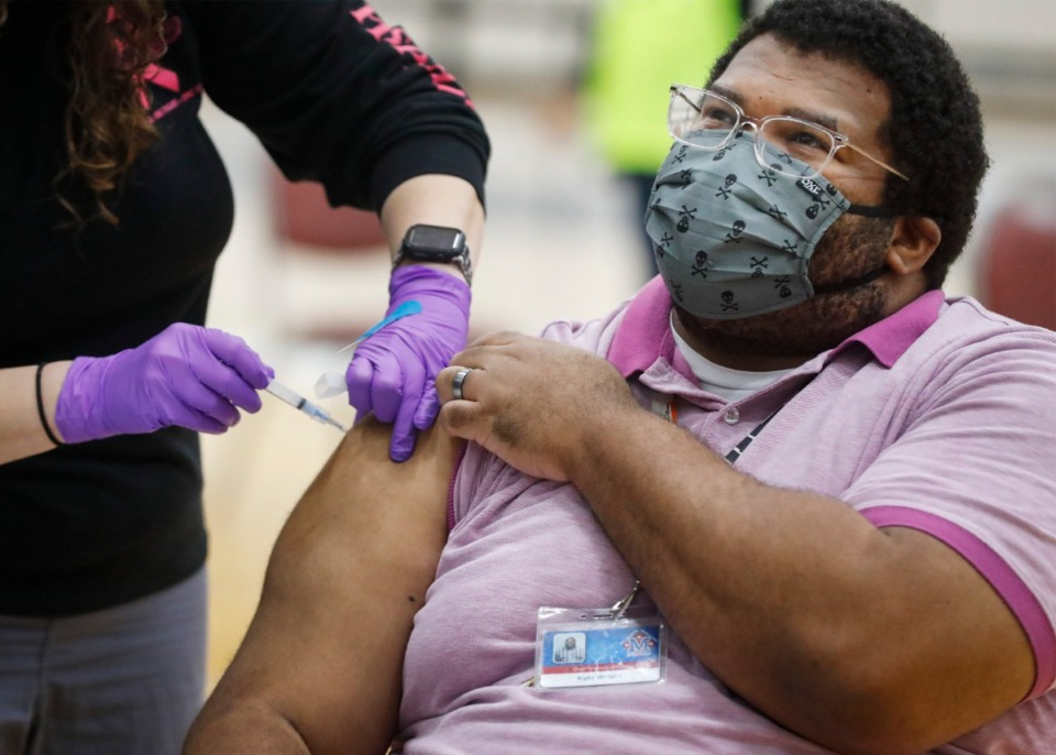 <strong>Kyle Wright receives a COVID-19 vaccination during a pop-up vaccine event at Arlington High School on March 26. Experts say 70% of Shelby County adults are likely immune to COVID.</strong> (Mark Weber/Daily Memphian file)