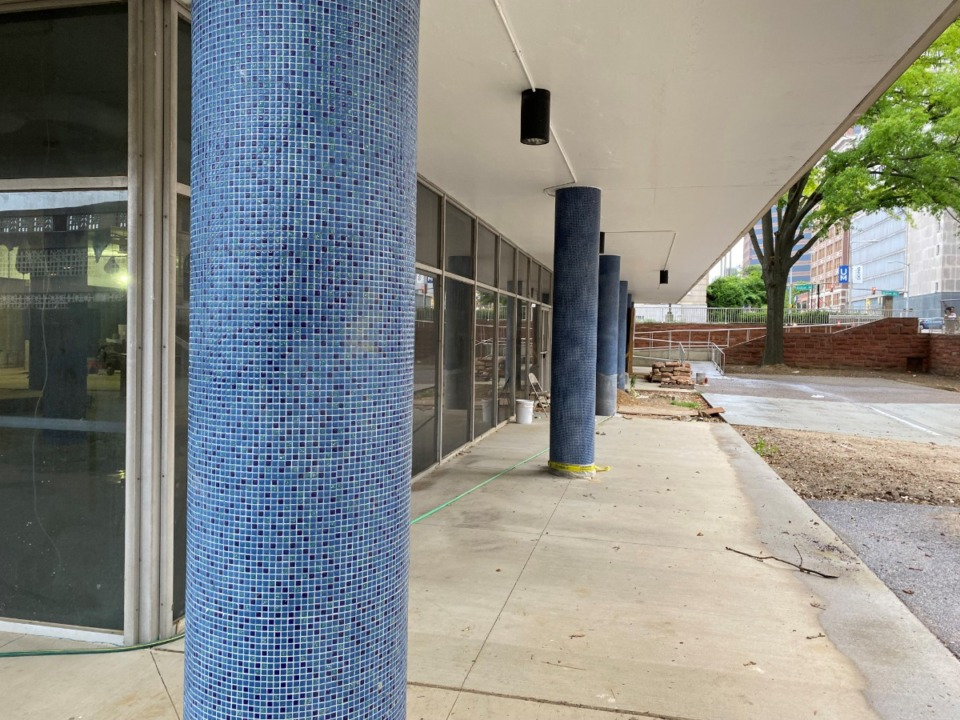 <strong>The blue mosaic tiles in the six columns across the front of the Cossitt Library are among the colors in an old painting that endure to this day.</strong> (Bill Dries/Daily Memphian)
