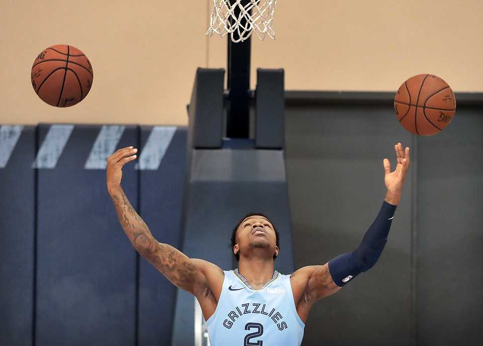 <strong>Grizzlies guard Brandon Goodwin tries to make a double-shot while waiting for photographers to shoot his portrait i the practice gym during the annual Grizzlies media day at the FedExForum on Sept. 24, 2018.</strong> (Jim Weber/Daily Memphian)