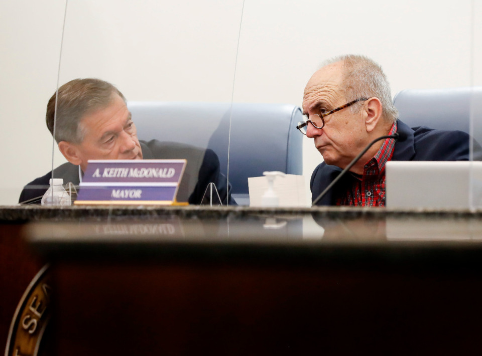 <strong>Bartlett&rsquo;s Chief Administrative Officer Mark Brown, left, and Mayor Keith McDonald converse during a meeting of the Bartlett Board of Mayor and Aldermen on Tuesday, May 25, 2021.</strong> <strong>Because of a scheduling issue, the board delayed key votes on the final reading regarding the fiscal year 2022 budget and tax rate until later this month.</strong> (Mark Weber/The Daily Memphian file)