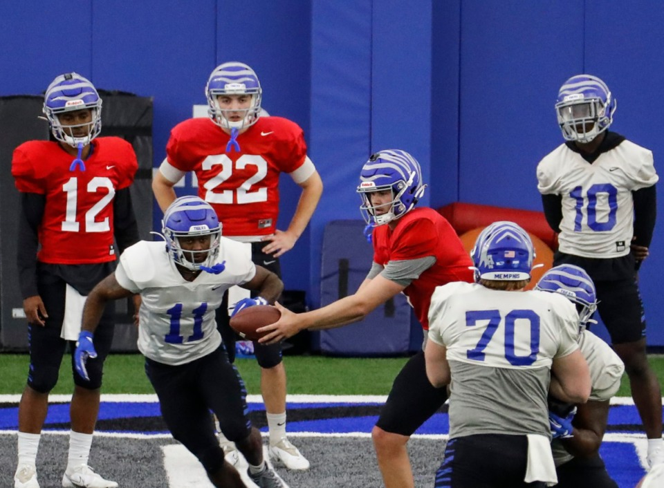 <strong>The Memphis Tigers (shown at spring practice on March 23) could potentially earn a spot in an expanded College Football Playoff. AAC teams will have to compete against the other G5 conferences for that slot, but the chances are still much higher than in the old format.</strong> (Mark Weber/Daily Memphian file)