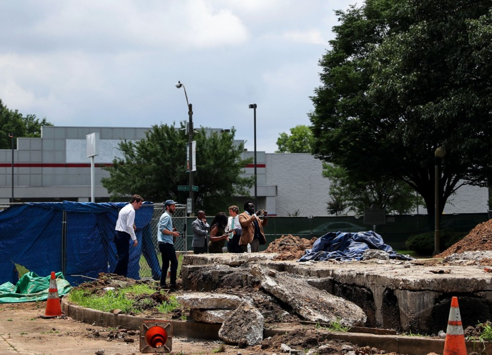 <strong>Members of the Memphis Greenspace board take a look at the now former grave of Nathan Forrest in Memphis, Tennessee June 11, 2021.</strong> (Patrick Lantrip/Daily Memphian)