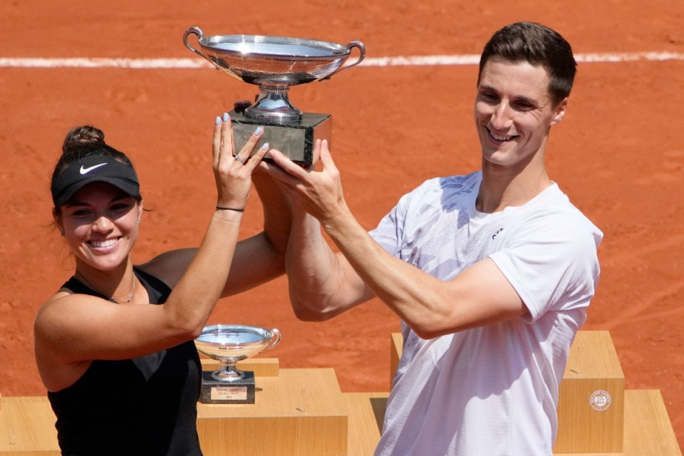 <strong>Former University of Memphis tennis player Joe Salisbury (right) and American Desirae Krawczyk hold the cup after defeating Russia's Elena Vesnina and Aslan Karatsev in their mixed doubles final match of the French Open tennis tournament at the Roland Garros stadium Thursday, June 10, 2021 in Paris.</strong> (Christophe Ena/AP)