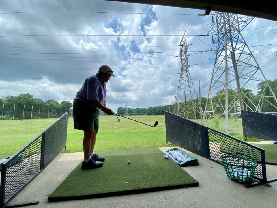 <strong>Mark Evans hits shots under the transmission wires at Golf &amp; Games Family Park on Friday, June 11. Organizers of the MAM Inaugural Helicopter Ball Drop fundraiser have measured to ensure the helicopter will have plenty of room between wires at noon, July 17.</strong> (Tom Bailey/Daily Memphian)