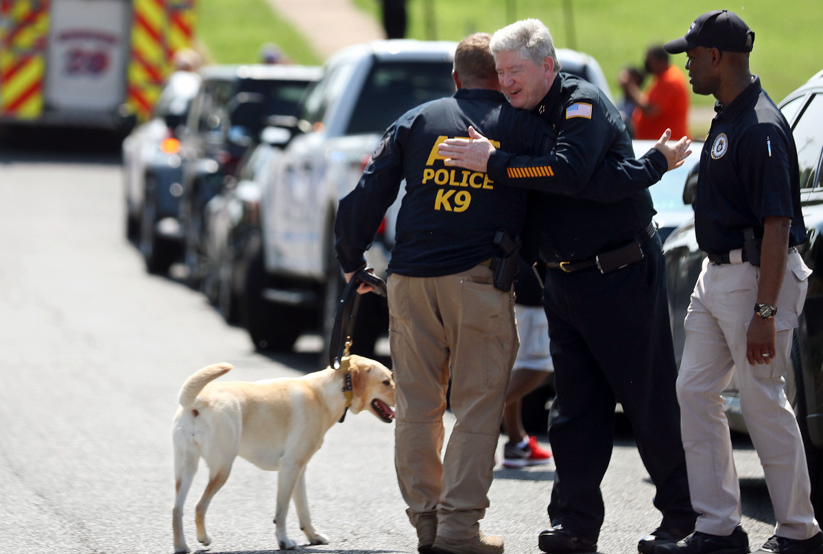 <strong>Memphis Police Department interim chief Mike Ryall hugs ATF special agent Mark Jordan, who's handling Piper, a 3-year-old explosives detection K-9, at the fourth Unity Walk Against Gun Violence at Hamilton High School June 12, 2021.</strong> (Patrick Lantrip/Daily Memphian)