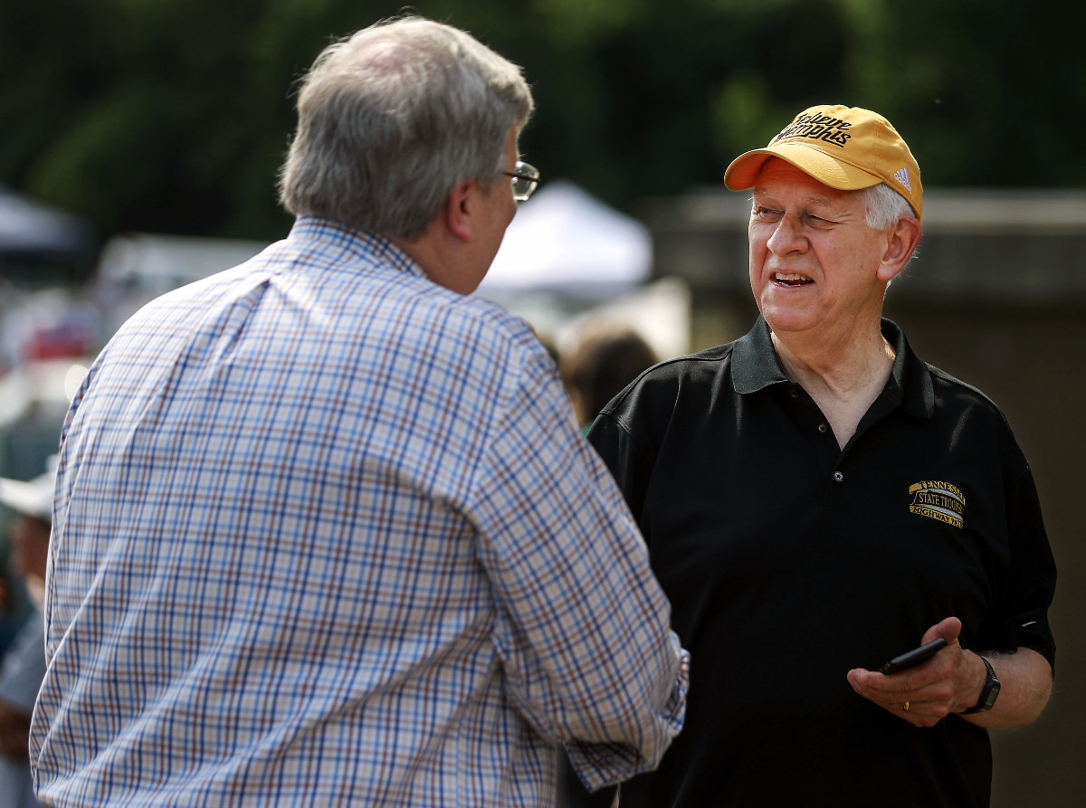 <strong>Mayor Jim Strickland shakes hands with Bill Gibbons, the executive director at The Public Safety Institute at the University of Memphis, at the fourth Unity Walk Against Gun Violence at Hamilton High School June 12, 2021.</strong> (Patrick Lantrip/Daily Memphian)