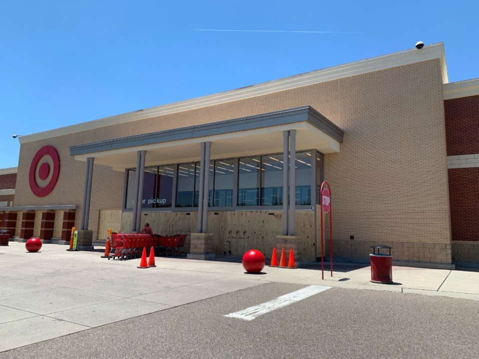 <strong>The entrance to the Target in Collierville is boarded up after a fire in the store Saturday. A reopening date has not been set.</strong> (Abigail Warren/Daily Memphian)
