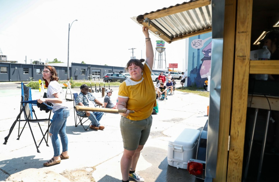 Heather Waldecker, co-owner of the Bain's Barbecue, prepares to open the Texas-style barbecue truck that parks on Broad Avenue on Sunday, May 16, 2021. (Mark Weber/The Daily Memphian)