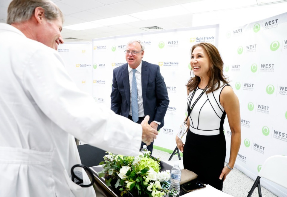<strong>West Cancer Center&rsquo;s CEO Mitch Graves (middle) and Dr. Sylvia Richey (right) greet Saint Francis Hospital staff members after announcing a partnership with the hospital on Tuesday, June 15, 2021.</strong> (Mark Weber/The Daily Memphian)