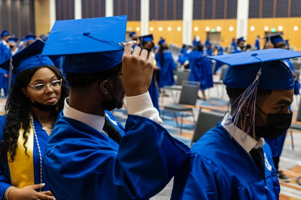 <strong>Graduates prepare before the start of the Watkins Overton High School Commencement at the Renasant Convention Center on June 16.</strong> (Brad Vest/Special to The Daily Memphian