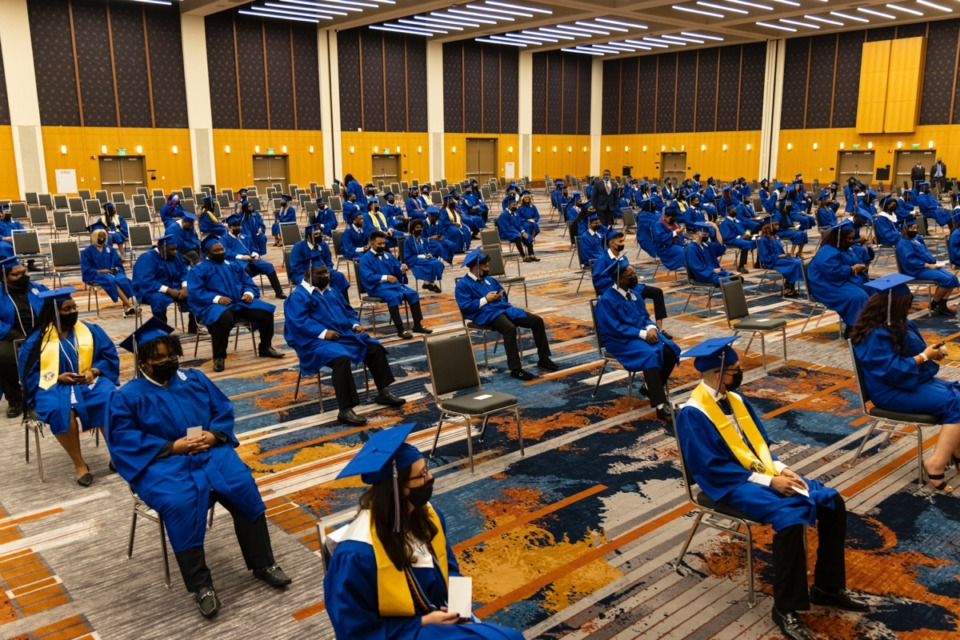 <strong>Socially distanced graduates wait before the start of the Watkins Overton High School Commencement at the Renasant Convention Center on June 16.</strong> (Brad Vest/Special to The Daily Memphian