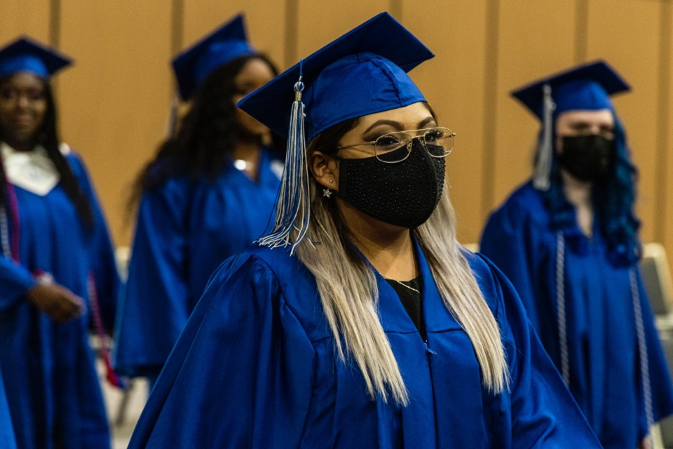 <strong>Graduates walk into the Renasant Convention Center Main Hall at the start of the Watkins Overton High School Commencement on June 16.</strong>&nbsp;(Brad Vest/Special to The Daily Memphian