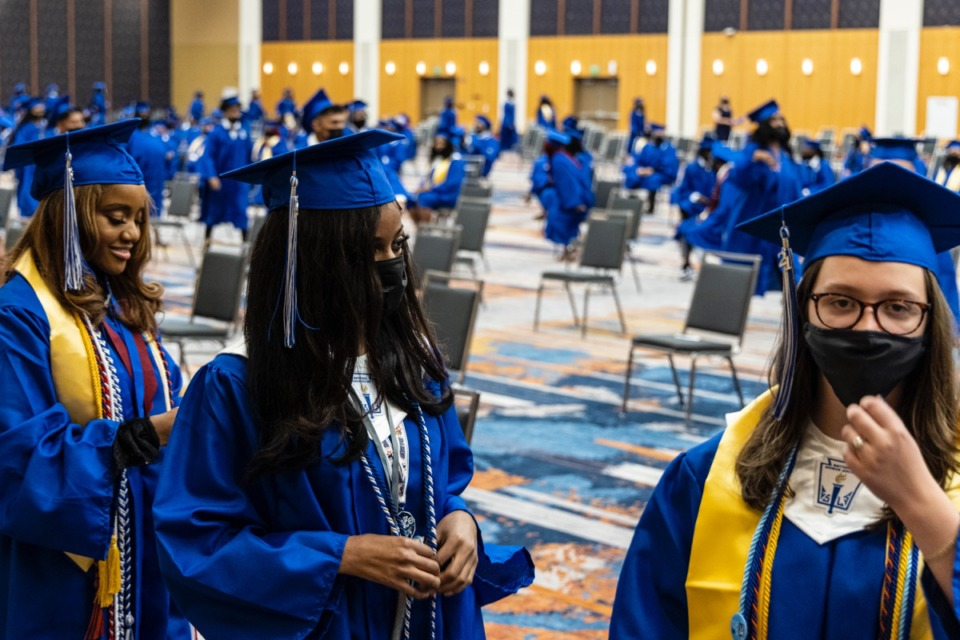 <strong>Graduates prepare for the start of the Watkins Overton High School Commencement at the Renasant Convention Center on June 16.</strong> (Brad Vest/Special to The Daily Memphian