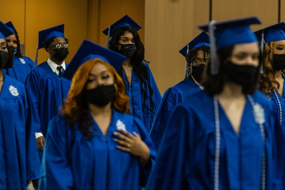<strong>Graduates walk into the Renasant Convention Center Main Hall at the start of the Watkins Overton High School Commencement on June 16.</strong> (Brad Vest/Special to The Daily Memphian