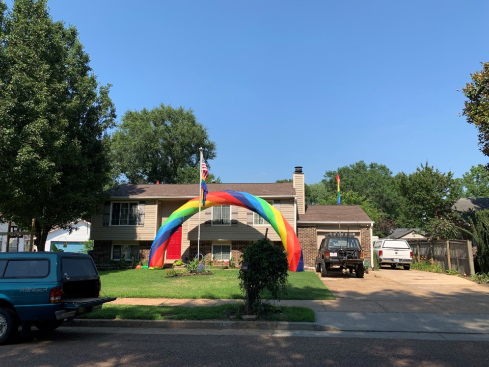 <strong>An inflatable rainbow and multiple feathered flags decorate the front of Nick Toombs&rsquo; home in celebration of Pride Month on Luther Road in Bartlett.</strong> (Omer Yusuf/Daily Memphian)